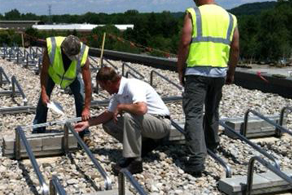 NEC engineers install solar panels